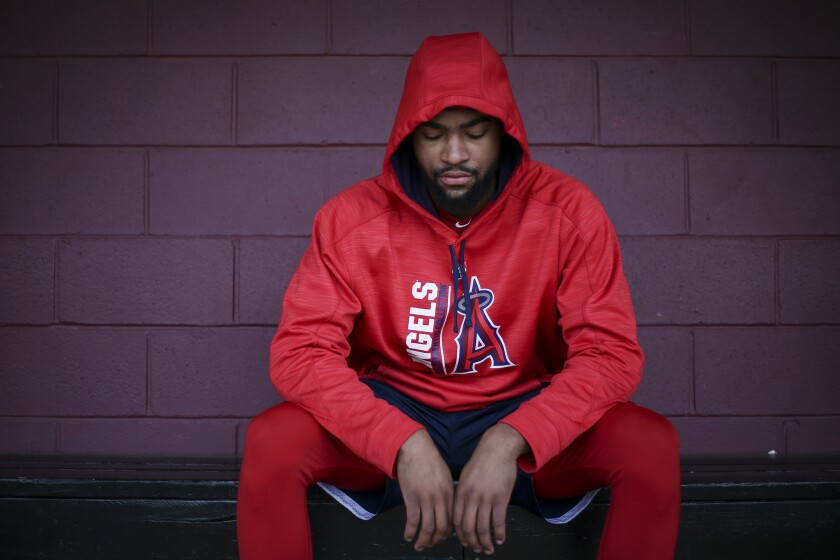 Angels prospect Jo Adell shows off his new attire inside his Ballard High dugout in Louisville, Ky., after being drafted.