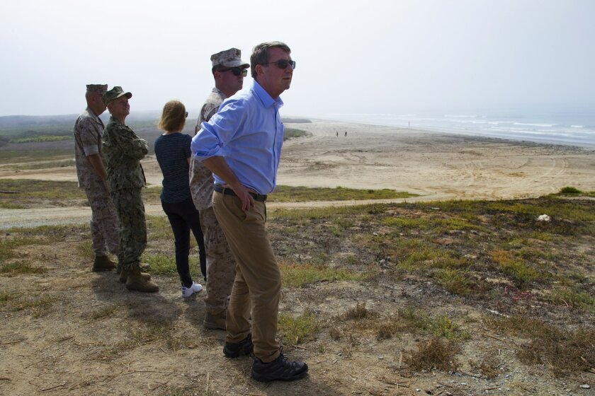 At Camp Pendleton, Secretary of Defense (SecDef) Ashton Carter watched as Reconnaissance Marines swam a shore to secure the beach for the landing of a Marine platoon size ground assault force.