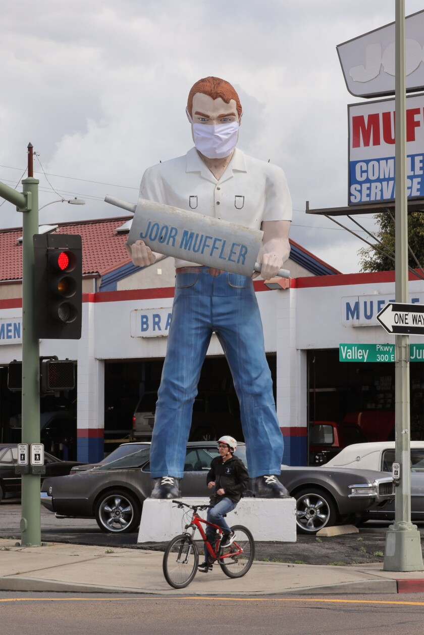 The Joor Muffler Man at Joor Muffler on East Valley Parkway at Juniper Street now wears a face mask in accordance with coronavirus guidelines.