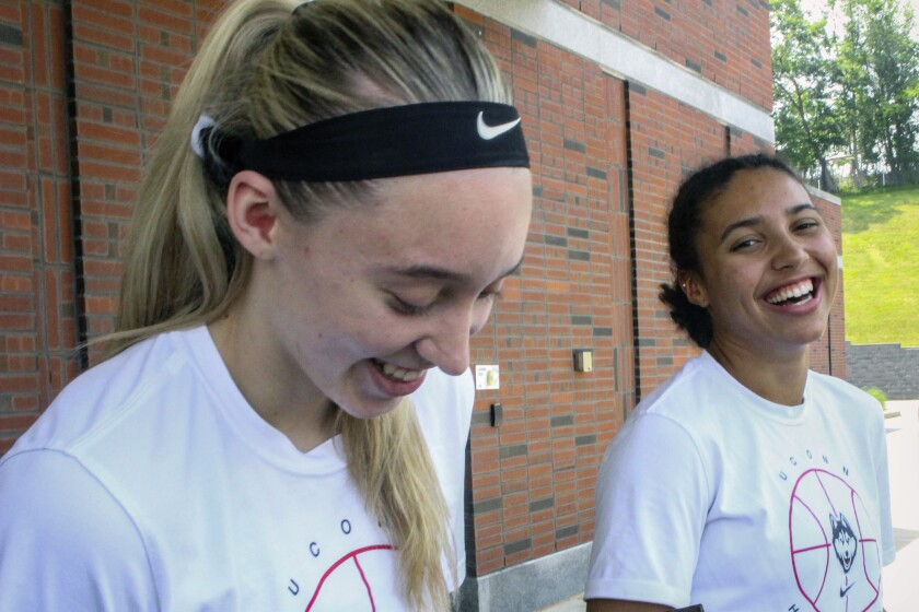 UConn basketball players Paige Bueckers, left, and Azzi Fudd, right, speak to the media outside the the school's Werth basketball practice facility on Tuesday, July 6, 2021. Bueckers, last season's national player of the year, helped recruit her friend Fudd, the nation's top high school prospect. (AP Photo/Pat Eaton-Robb)