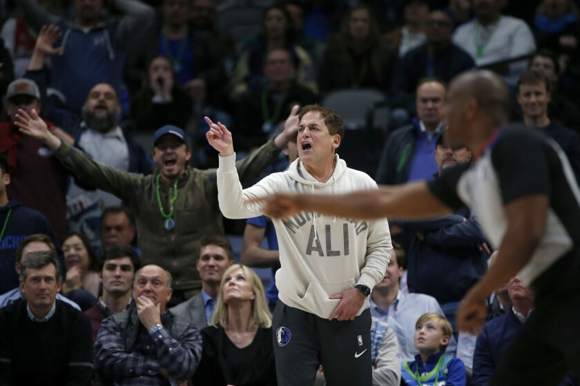 Dallas Mavericks owner Mark Cuban argues a call as they played the Utah Jazz during the second half an NBA basketball game in Dallas, Monday, Feb. 10, 2020. Utah defeated Dallas 123-119. (AP Photo/Michael Ainsworth)