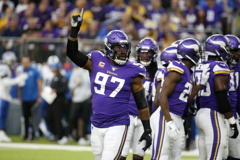 FILE - Minnesota Vikings defensive end Everson Griffen (97) signals teammates during the first half of an NFL football game against the Detroit Lions in Minneapolis, in this Sunday, Dec. 8, 2019, file photo. The Minnesota Vikings are bringing back defensive end Everson Griffen, now the fourth player on defense to rejoin the team this year after time away with another team. (AP Photo/Bruce Kluckhohn, File)