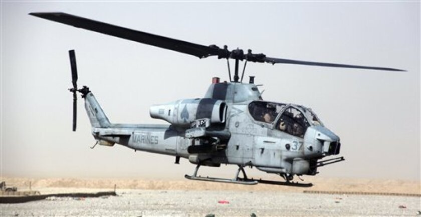 """This undated image shows a AH-1W """"Cobra"""" helicopter. Seven Marines were killed in a collision of two helicopters, one of them similar to this one, near Yuma, Ariz., during night training exercises Feb. 22, 2012. One of those killed was based in Yuma, the rest at Camp Pendleton. The crash involved a Cobra and a UH-1 """"Huey"""". (US Marines)"""