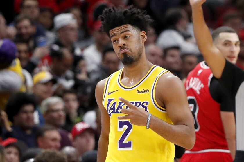 Lakers' Quinn Cook looks back at his bench and reacts after hitting a three-pointer during the second half against the Chicago Bulls on Nov. 5, 2019 in Chicago.