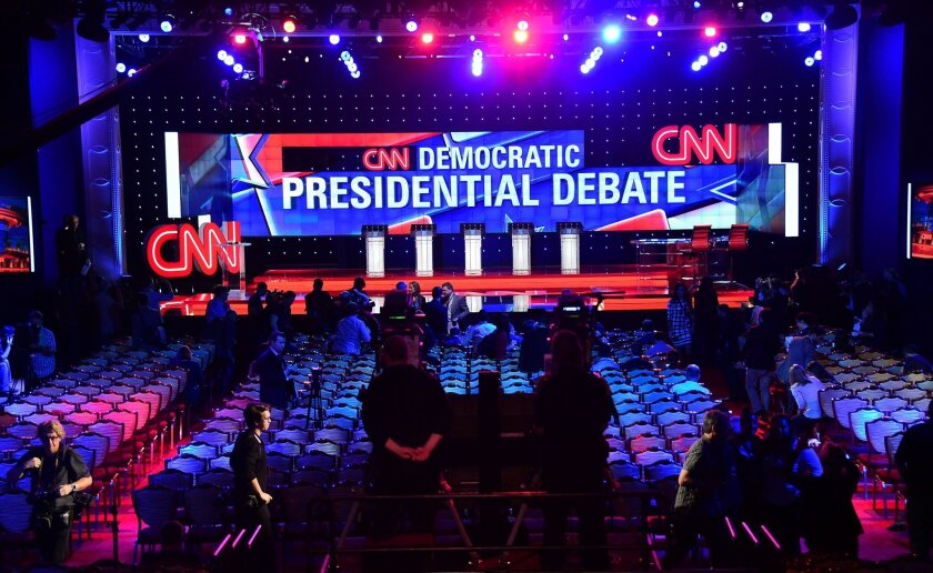 Members of the media are given a preview of the debate hall at the Wynn Hotel in Las Vegas hours before the first Democratic presidential debate.