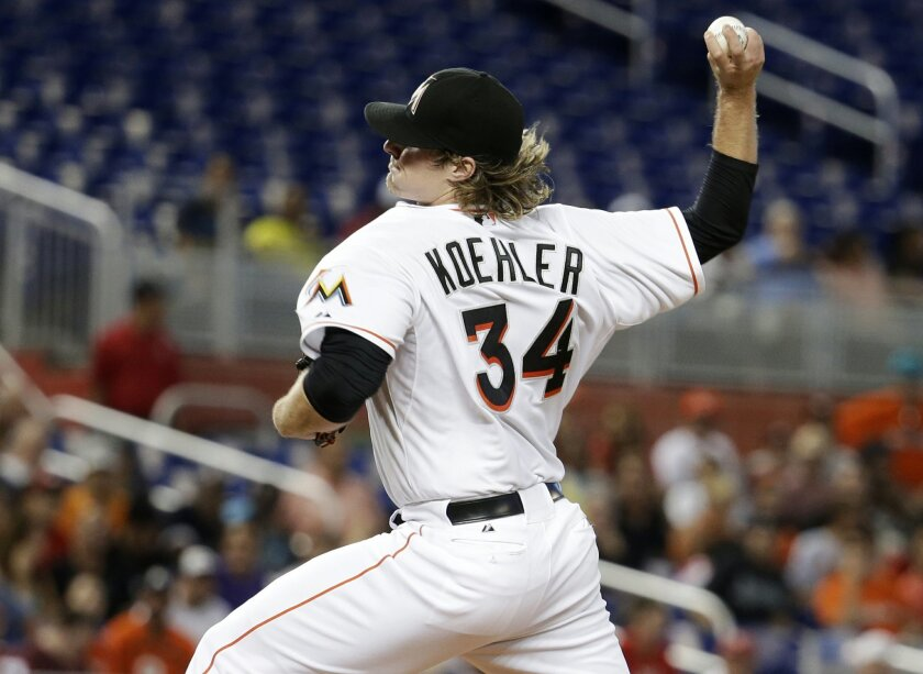 Miami Marlins starting pitcher Tom Koehler throws in the first inning during a baseball game against the St. Louis Cardinals, Monday, Aug. 11, 2014, in Miami. (AP Photo/Lynne Sladky)