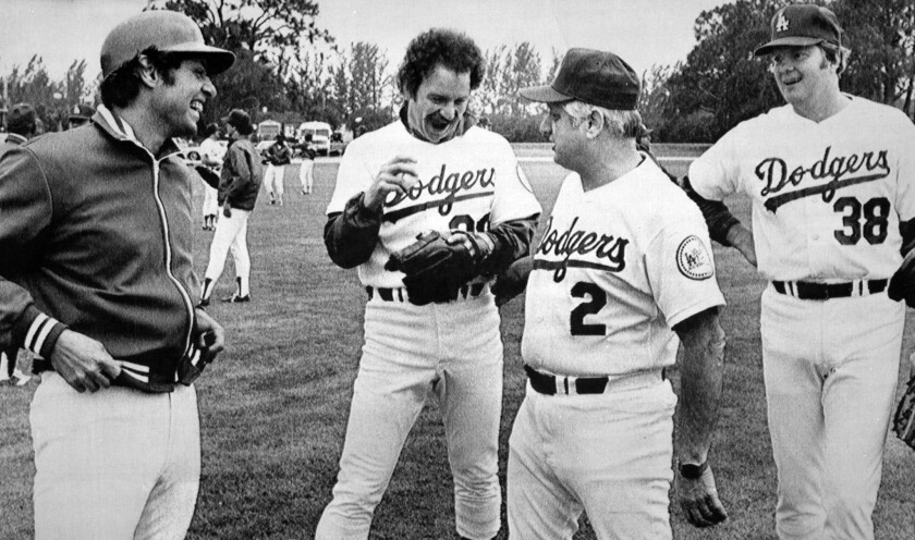 Jay Johnstone, left, laughs with teammates Don Stanhouse and Dave Goltz along with manager Tommy Lasorda in 1980.