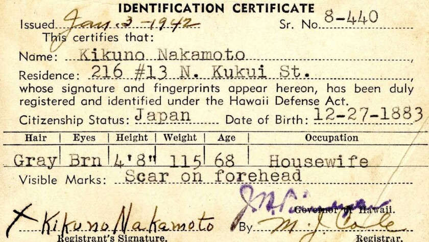 An identity card, issued to a Hawaii resident of Japanese heritage, forms part of the Bishop's Museum's exhibit about the local impact of the attack on Pearl Harbor. Hundreds of Japanese-Americans were interned throughout the war.