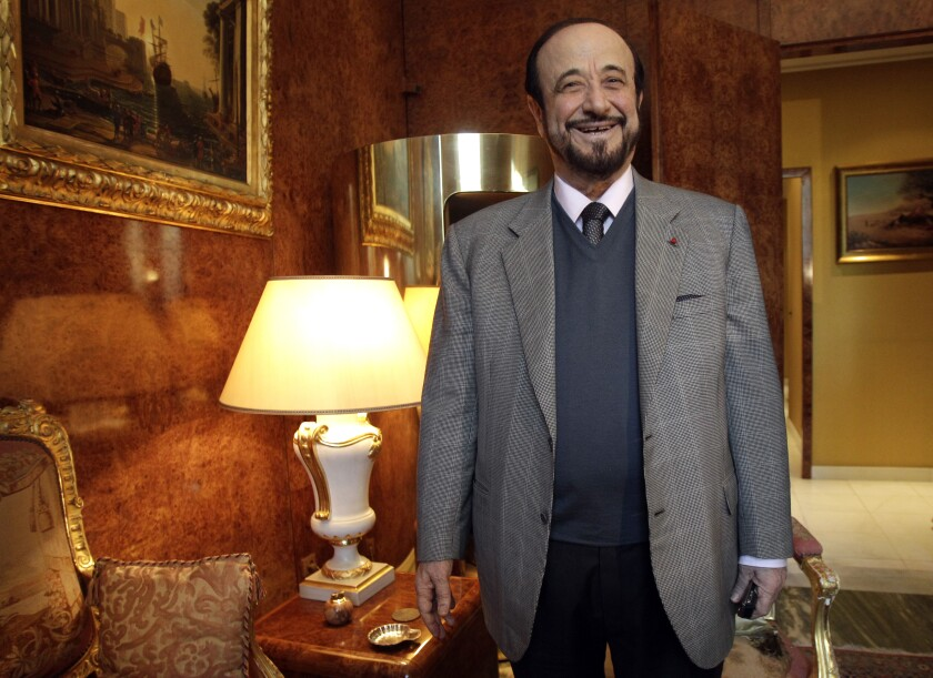 FILE - In this Tuesday Nov. 15, 2011 file picture, Rifaat Assad poses for a photographer in Paris. Rifaat al-Assad, the uncle of Syrian President Bashar al-Assad, is going to trial in Paris, where he stands accused of illegally using Syrian state funds to build a French real estate empire.AP Photo/Michel Euler, File)
