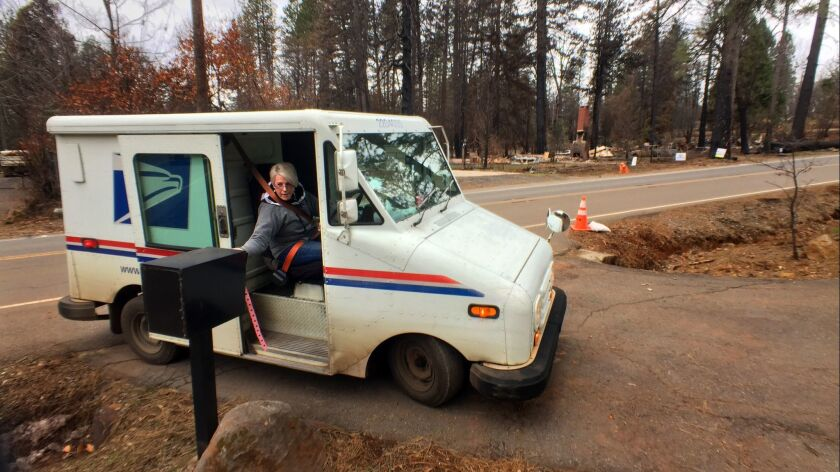 Postal worker Theresa Knowles delivered mail recently to residents of Paradise, Calif., whose homes survived the deadly Camp fire.