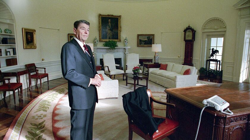 Ronald Reagan takes a last look around the Oval Office (note the bare desk), January 20, 1989. An im