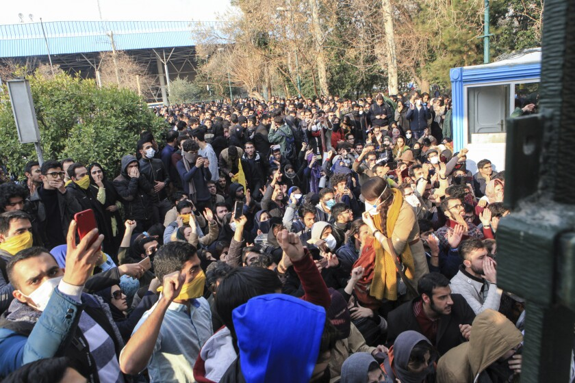 Students at a protest outside Tehran University in 2017.