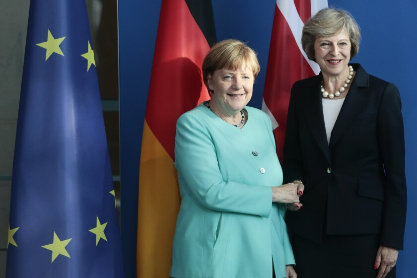 German Chancellor Angela Merkel, left, and British Prime Minister Theresa May shake hands after a news conference during a meeting at the chancellery in Berlin Wednesday, July 20, 2016, on May's first foreign trip after being named British Prime Minister. (AP Photo/Markus Schreiber)
