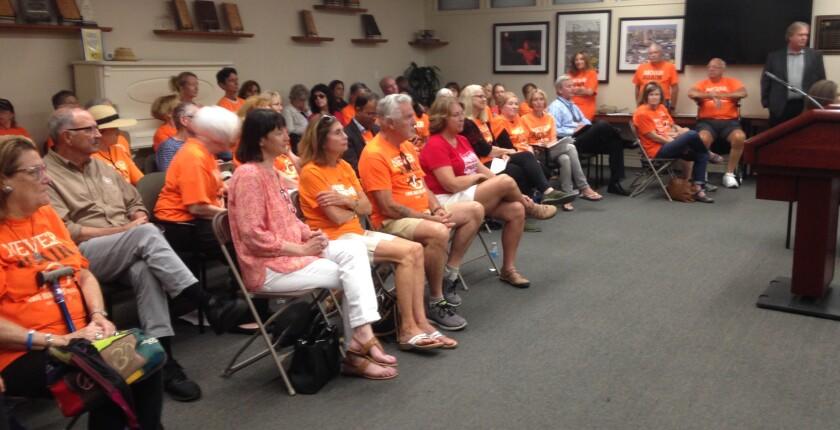 NeverAgainCA members filled the Del Mar fair board meeting Tuesday.