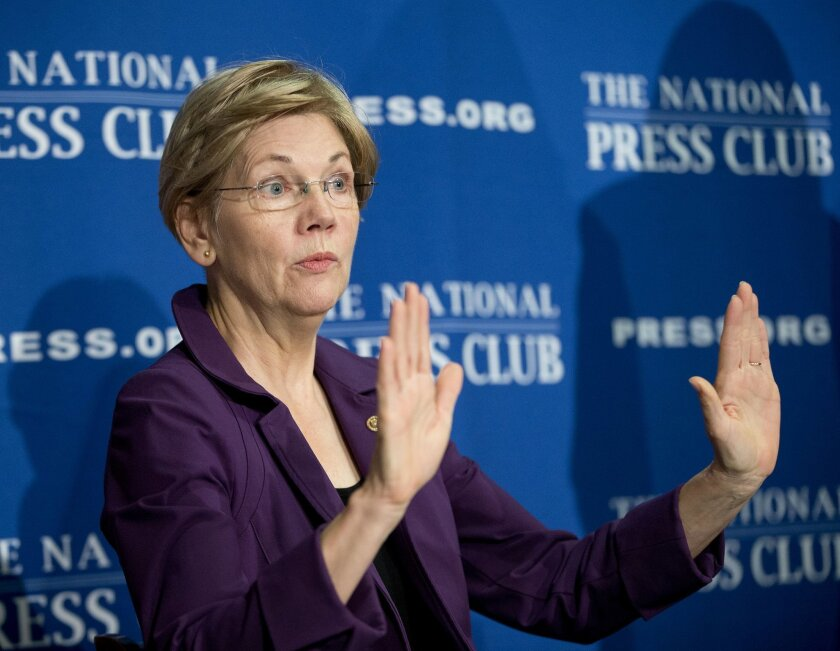 FILE - In this Nov. 18, 2015, file photo, Sen. Elizabeth Warren, D-Mass. gestures before speaking at the National Press Club in Washington. A coveted but coy Warren is for now staying painstakingly neutral in the Democratic presidential contest, frustrating Hillary Clinton's and Bernie Sanders' sup