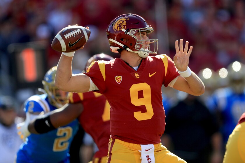 USC quarterback Kedon Slovis passes during the first half against UCLA at the Coliseum on Nov. 23, 2019.