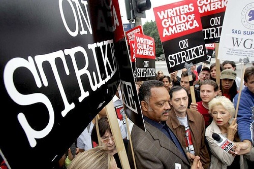 SUPPORT: The Rev. Jesse Jackson, from left, visits the picket line at Paramount Pictures with WGA President Patric M. Verrone and France Nuyen, a national board member of the Screen Actors Guild.