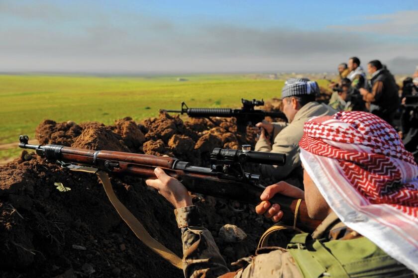 Iraqi Kurds fight Islamic State militants near Mosul on Jan. 21.