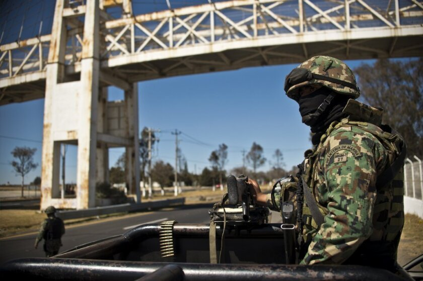 Members of the Mexican navy patrol a highway in the state of Mexico, near the capital, Toluca. According to local authorities, 3,000 members of the navy, army, federal police and state police have been deployed since Jan. 24 for the anti-crime Operation Shield.