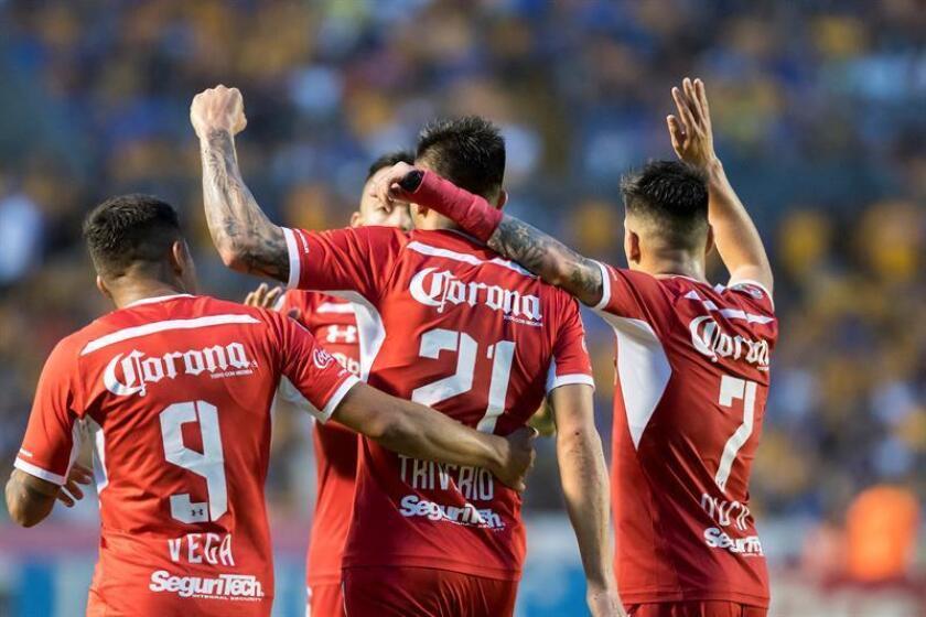 Players of the Diablos Rojos de Toluca celebrate a goal against Tigres on Aug. 11, 2018 in Monterrey, Mexico. EPA- EFE/Miguel Sierra