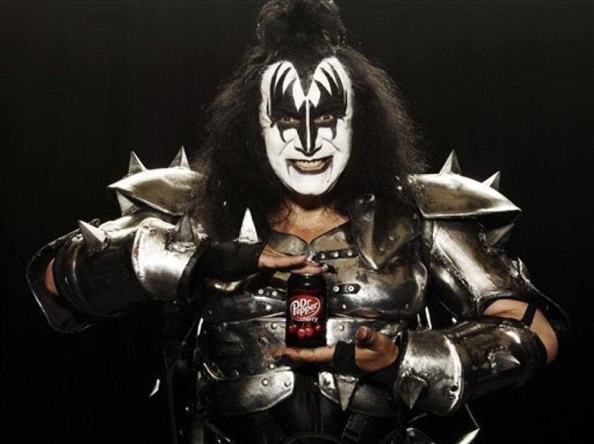 This image provided by Dr. Pepper Snapple shows part of a television ad featuring Kiss band member Gene Simmons that aired during the 2010 Super Bowl. (AP Photo/Dr. Pepper Snapple) NO SALES