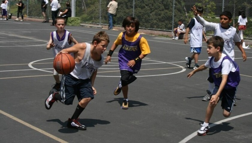 Boys take part in a game during Camps Lakers.