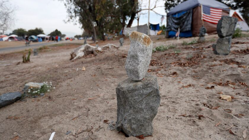 "The ""Rock Memorial"" setup at a homeless encampment along the Santa Ana River Trail in Anaheim on Wed"