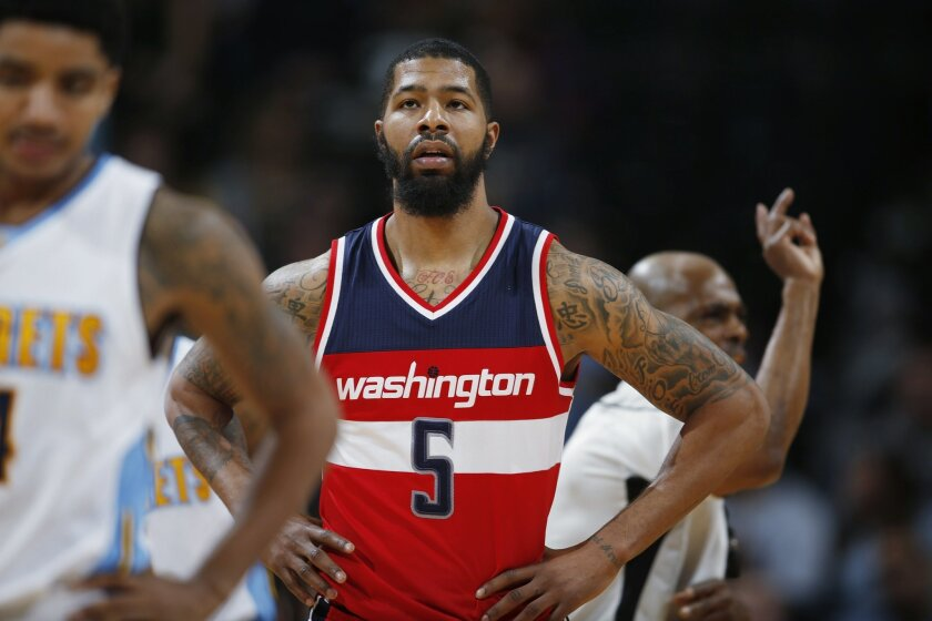 FILE - In this March 12, 2016, file photo, Washington Wizards forward Markieff Morris (5) pauses during the team's NBA basketball game against the Colorado Nuggets, during a stoppage in play. A person familiar with the situation says Morris was detained at Philadelphia International Airport and the