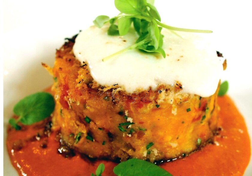 Butternut Squash Cakes With Roasted Red Bell Peppers, Fresh Mozzarella & Smoked Paprika Cream Sauce created by Alfred Fierro, chef of The Brasserie restaurant.