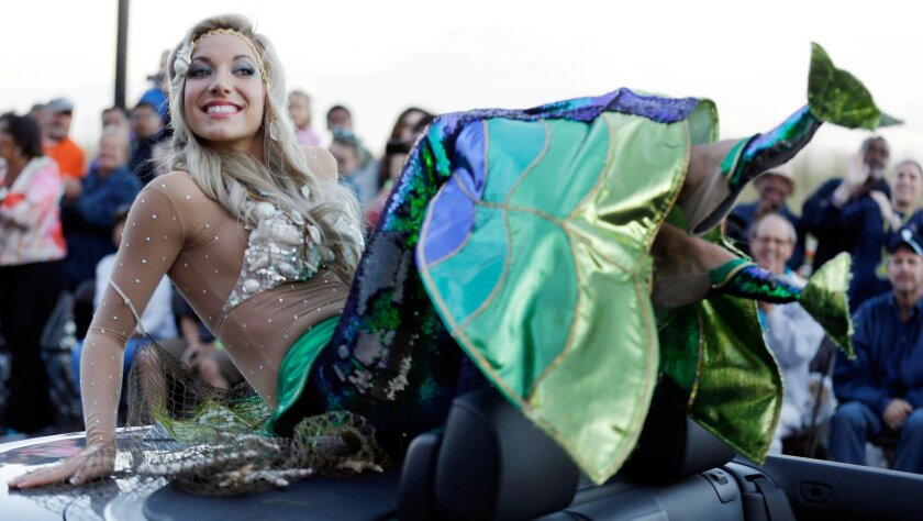 FILE - In this Sept. 14, 2013 file photo Miss New Jersey Cara McCollum displays her shoes during the Miss America Shoe Parade at the Atlantic City, N.J. boardwalk. McCollum was critically injured when her convertible spun off a highway and hit a tree, state police said Tuesday. (AP Photo/Julio Cort
