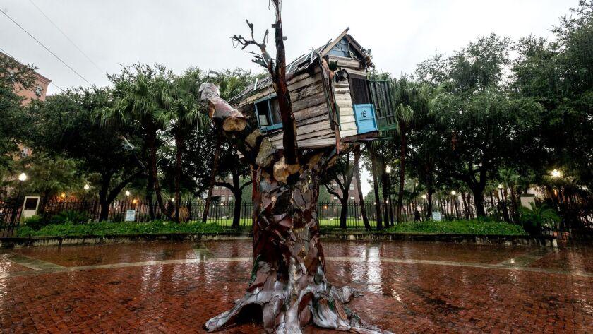 "Rain falls Tuesday on the ""Scrap House,"" artist Sally Heller's memorial to victims of Hurricane Katr"