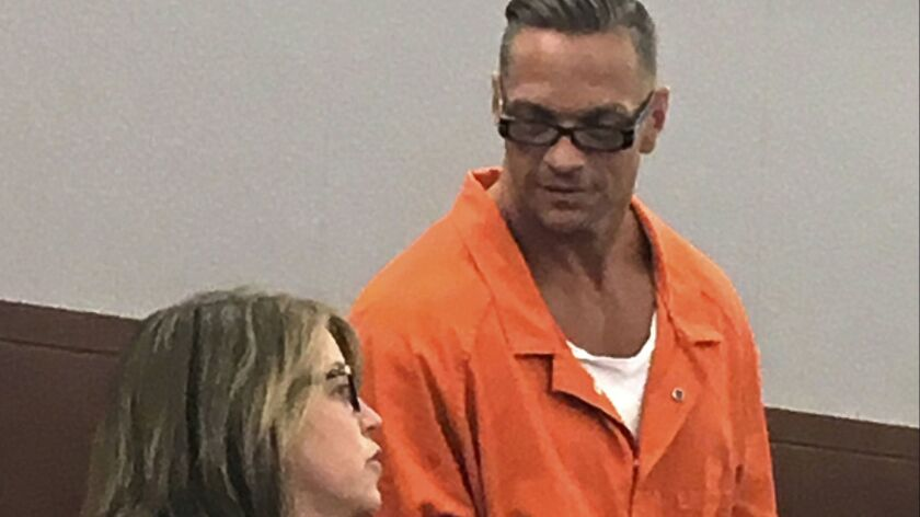 Nevada death row inmate Scott Dozier confers with his attorney during a court appearance in August 2017.