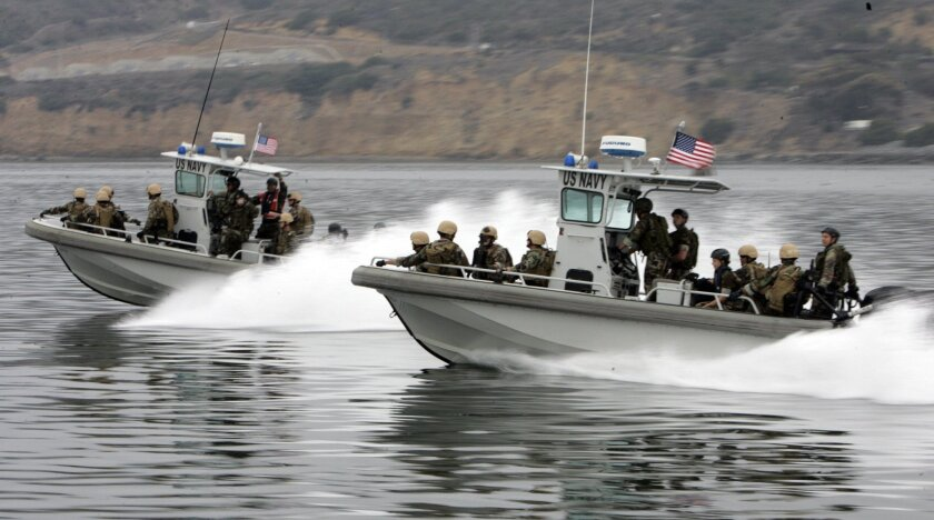 The Navy is planning an anti-terrorism exercise across all its bases this week, including those in San Diego. Here, two boats in a similar drill in the San Diego Bay in 2007.