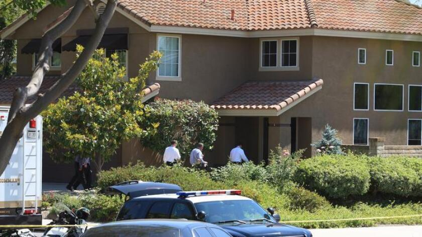 An investigation is underway in an upscale home in Mission Viejo, where the bodies of two males and two females were found in an apparent murder-suicide.