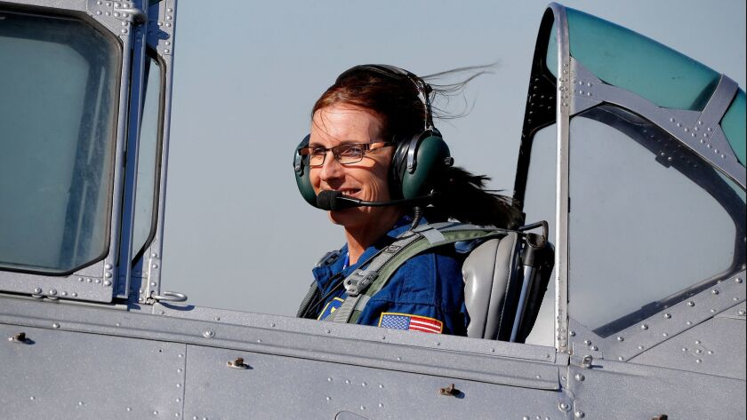 U.S. Rep. Martha McSally, R-Ariz., leaves in a T-6 World War II airplane after speaking at a rally,