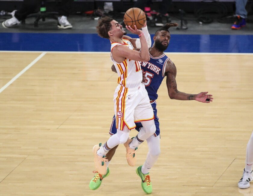 Atlanta Hawks guard Trae Young (11) shoots a 3-pointer as New York Knicks forward Reggie Bullock (25) defends during the fourth quarter of Game 5 of an NBA basketball first-round playoff series Wednesday, June 2, 2021, in New York. (Wendell Cruz/Pool Photo via AP)