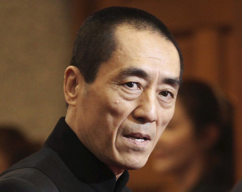 FILE - In this Tuesday, Oct. 30, 2012 file photo, Chinese director Zhang Yimou arrives to attend Daejong Film Festival in Seoul, South Korea. Zhang must pay more than $1.2 million in fines for having three children in violation of China's strict family planning rules, officials said Thursday, Jan. 9, 2014. (AP Photo/Ahn Young-joon, File)