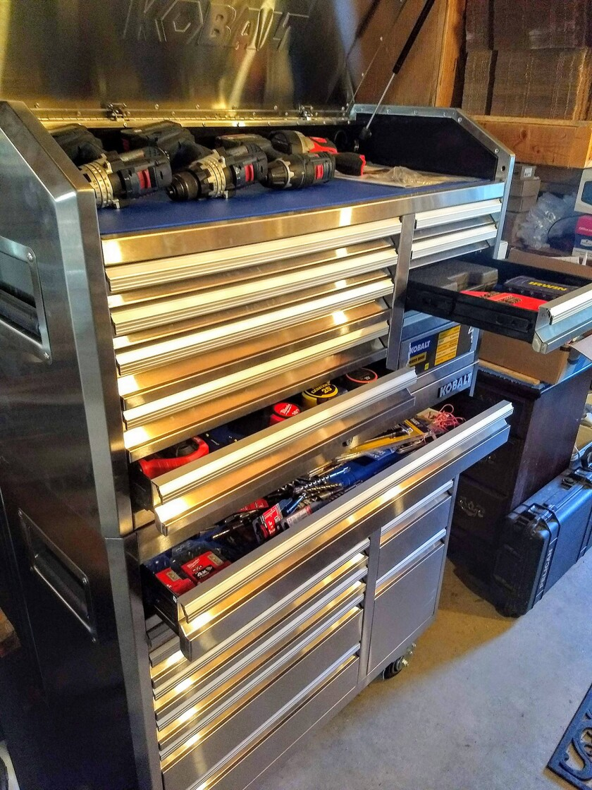 A rolling double-decker tool cabinet is a great way to wrangle hand tools.
