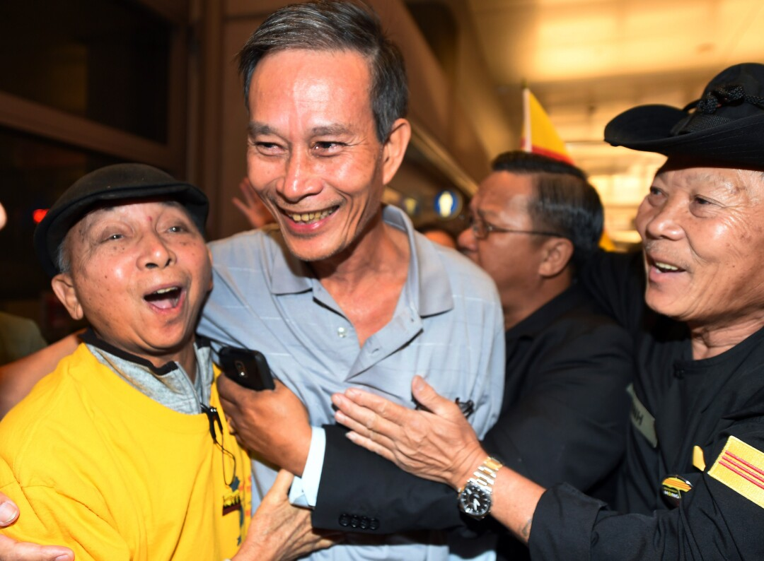 Freed Vietnamese dissident Nguyen Van Hai, center, is greeted upon arrival at LAX in 2014.