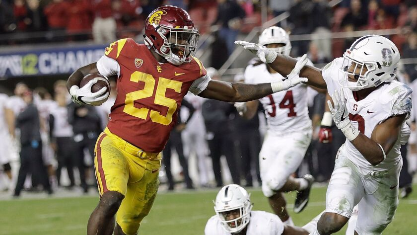 USC running back Ronald Jones II beats Stanford defenders, including safety Justin Reid, for one of his two touchdowns in the second half Friday.