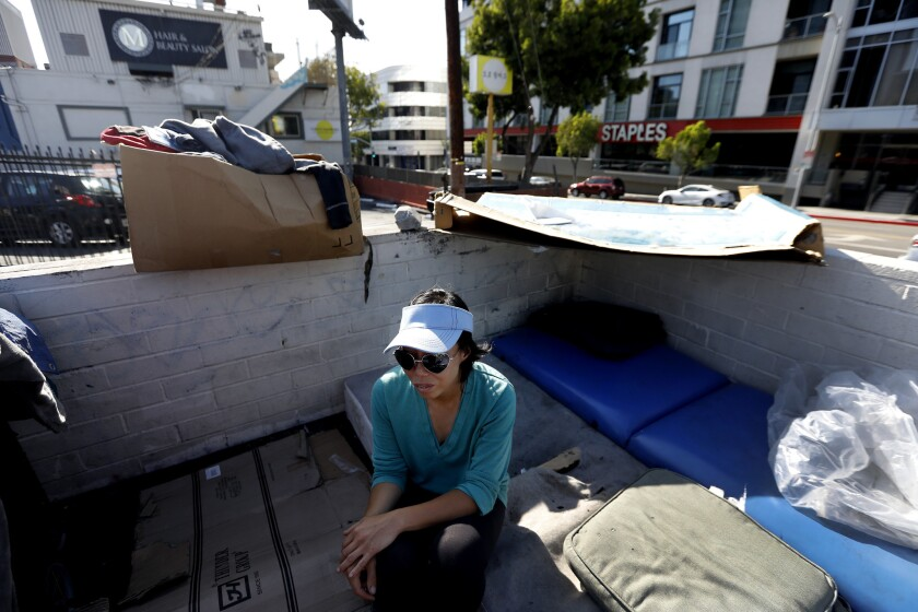 LOS ANGELES, CA MAY 13, 2018: Denise Lee, 35, sits next to her tent in a parking lot near 6th and