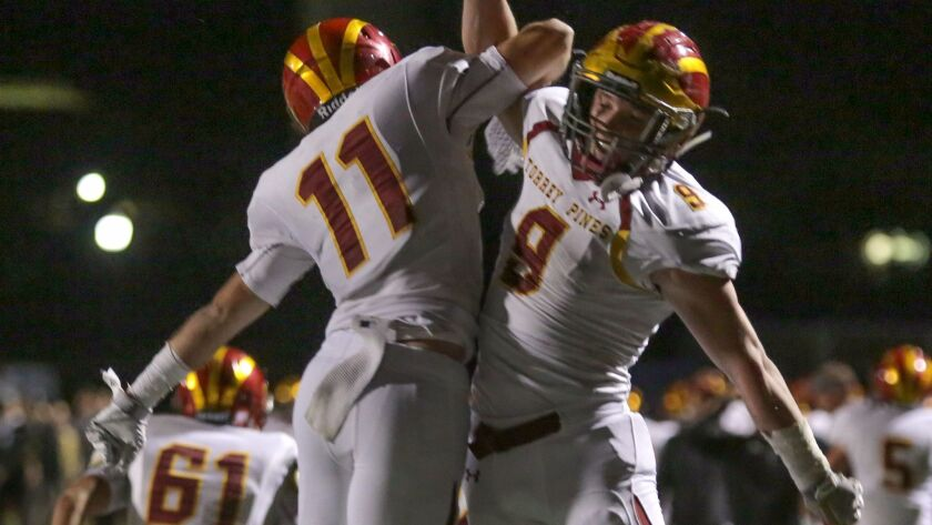 Torrey Pines running backs Sully O'Brien (left) and Mac Bingham celebrate O'Brien's touchdown run in last week's quarterfinal win over La Costa Canyon.