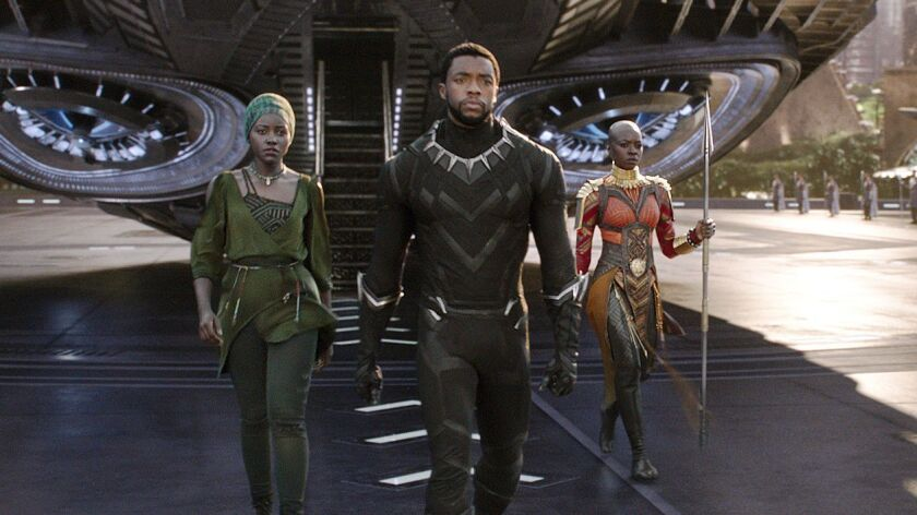 This image released by Disney shows Lupita Nyong'o, from left, and Chadwick Boseman and Danai Gurira