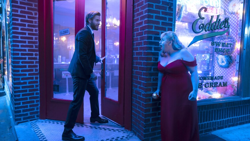 "Liam Hemsworth as Blake and Rebel Wilson as Natalie in New Line Cinema's comedy ""Isn't It Romantic?"""
