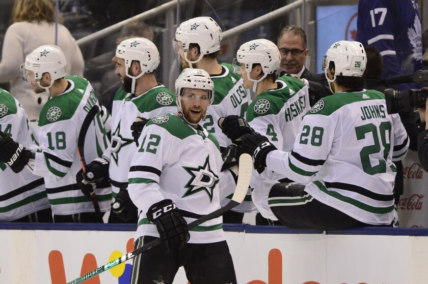 Dallas Stars centre Radek Faksa (12) celebrates with teammates on the bench after scoring against the Toronto Maple Leafs during the second period of an NHL hockey game Thursday, Feb. 13, 2020, in Toronto. (Frank Gunn/The Canadian Press via AP)