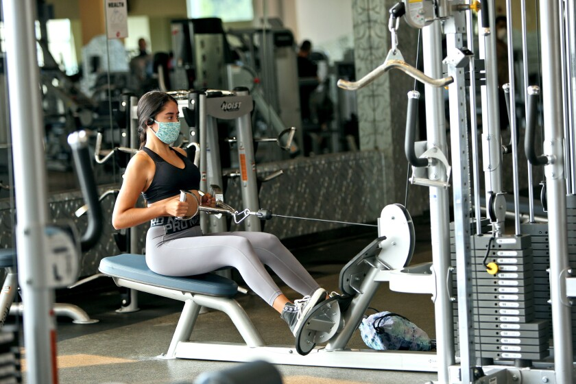 A woman works out in a gym