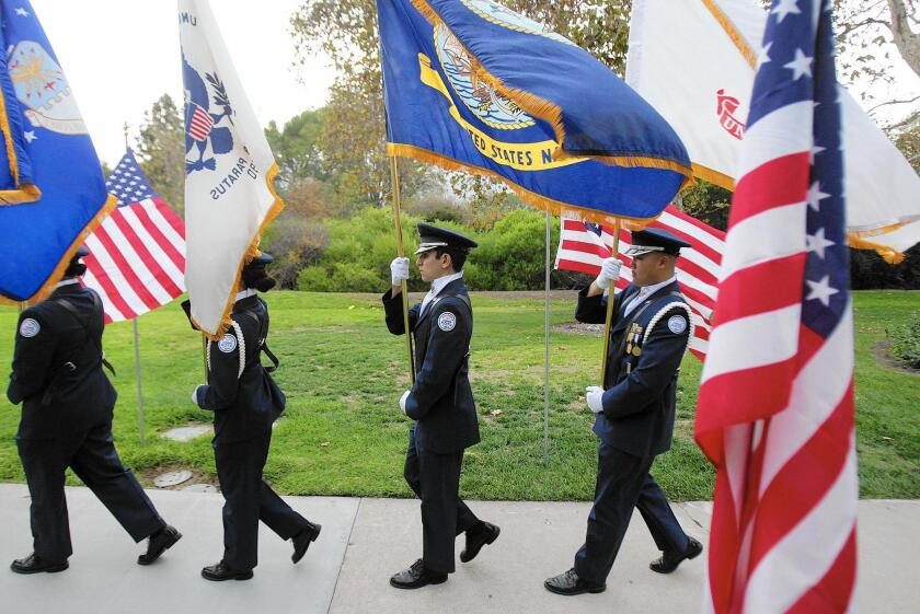 The Crescenta Valley High Junior ROTC present the colors during the Veteran's Day Vigil at Two Strike War Memorial Park in this file photo taken on Tuesday, Nov. 11, 2014.