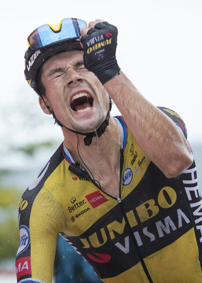 Primoz Roglic crosses the line to win the 17th stage of La Vuelta cycling race between Unquera and Lagos de Covadonga, Spain, Wednesday, Sept. 1, 2021. (AP Photo/Lalo R. Villar)