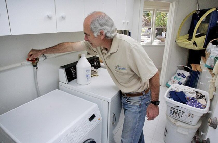 Dadla Ponizil had his Encinitas home renovated to allow rinse water from his washing machine drain to the blackberry patch in his front yard. (Bruce K. Huff / Union-Tribune)