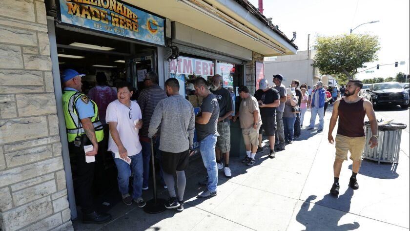People wait in line outside of Bluebird Liquor in Hawthorne to buy Mega Millions lottery tickets in 2018.